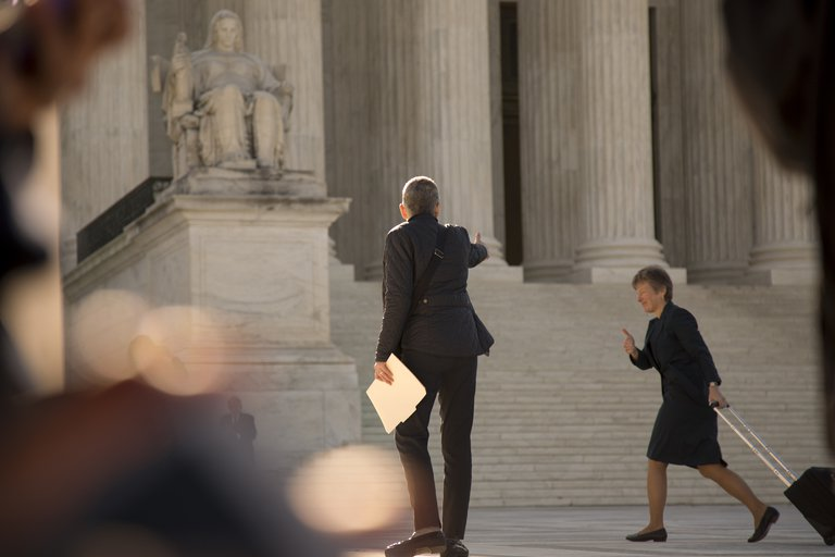 'Marriage Equality: Mary Bonauto (with suitcase) gives the thumbs up to Mary Breslauer as she enters the Supreme Court. Bonauto is arguing the case today' found at https://flic.kr/p/smMsGv by Lorie Shaull (https://flickr.com/people/number7cloud) used under Creative Commons Attribution-ShareAlike License (http://creativecommons.org/licenses/by-sa/2.0/)