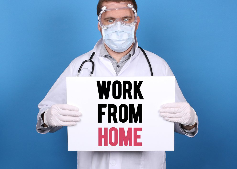 'Work From Home. Doctor holding message sign for COVID-19 Pandemic at blue background' found at https://flic.kr/p/2iNhYKS by focusonmore.com (https://flickr.com/people/null) used under Creative Commons Attribution License (http://creativecommons.org/licenses/by/2.0/)